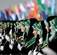 Basij militia with green keffiyeh under chador